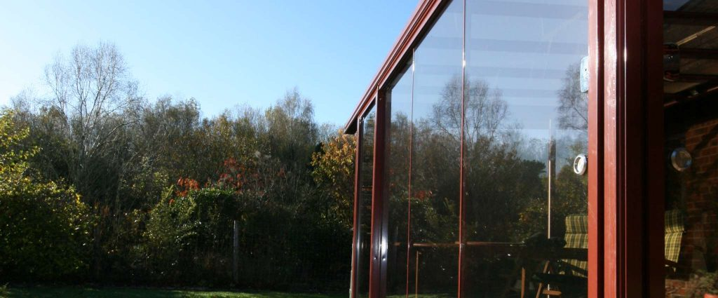 Alihaus modern glass structure on rear of home in garden